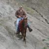 Trail Riding, Tom and his trusted foxtrotter navigate down hill.